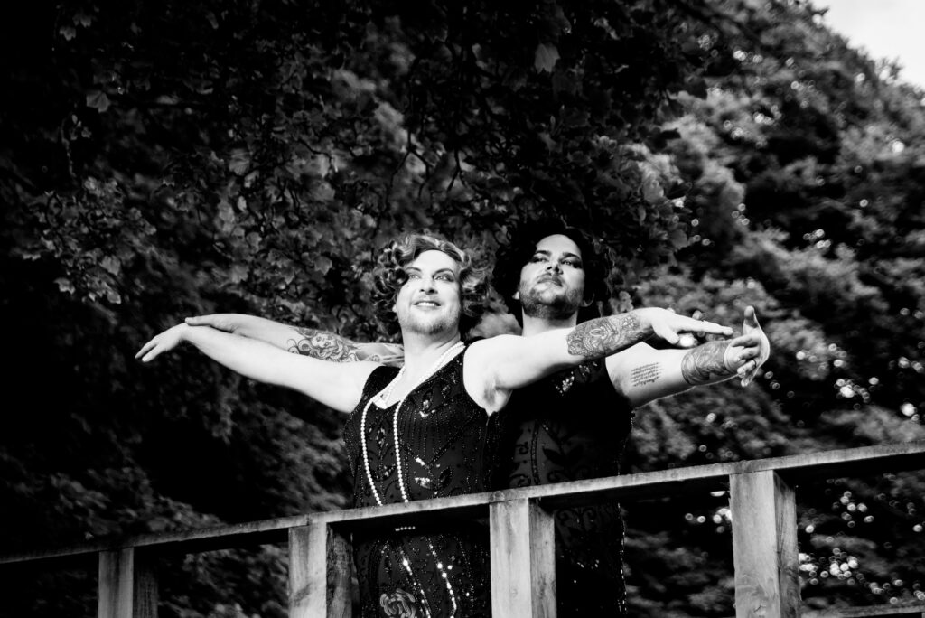 Grooms reenacting that seen from Titanic in drag