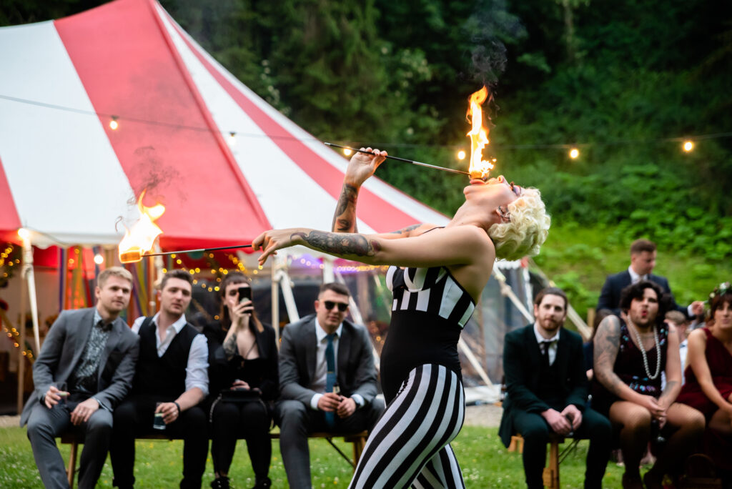 Fire breather Bella Stanyer performing at a wedding