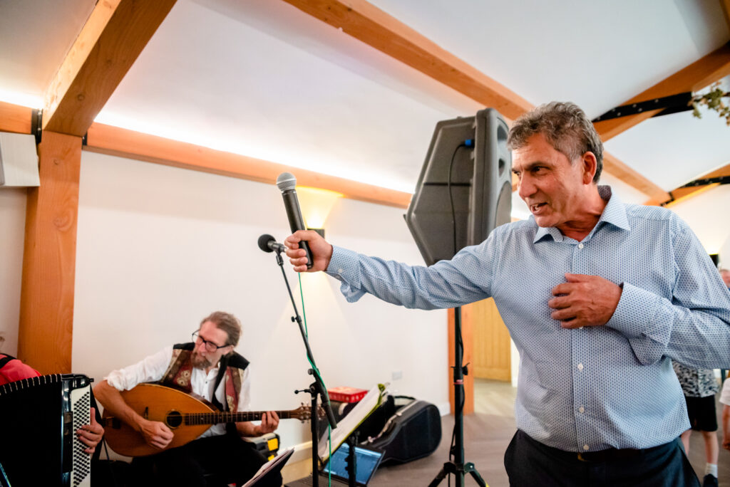 Dad singing with the band at Hanbury Wedding Barn