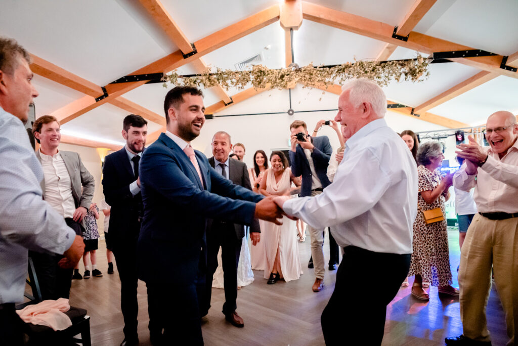 Dad dancing with his father in law