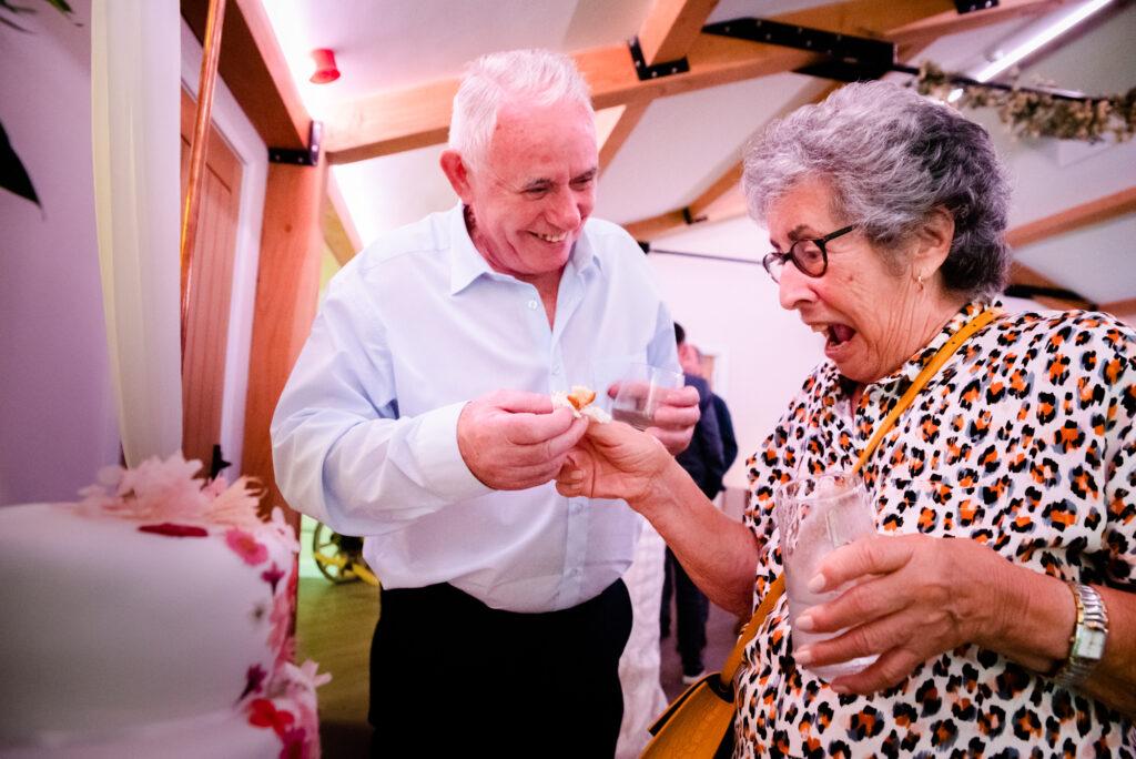 Grandma tasting the cake