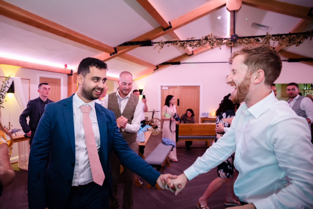 groom dancing with a friend