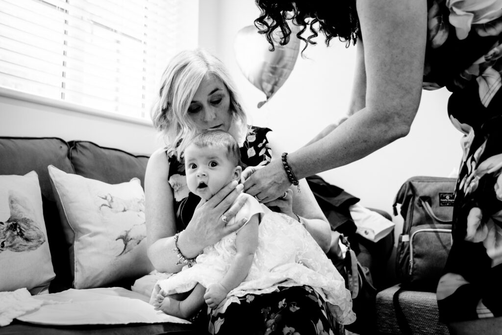 Dressing up the bride's baby for the ceremony