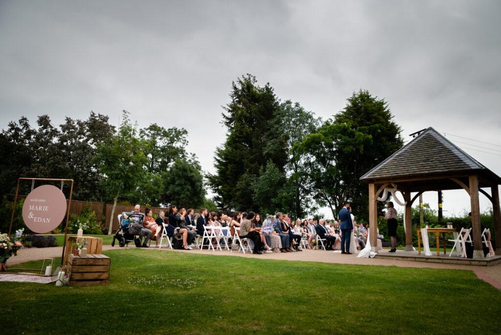 Outdoor wedding ceremony at Hanbury Wedding Barn