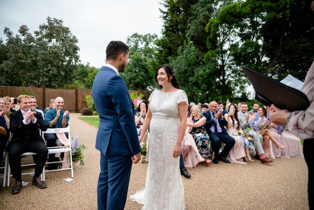 Exchanging vows at Hanbury Wedding Barn