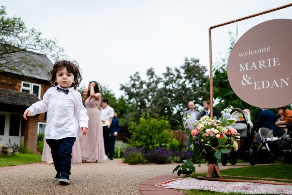 Toddler leaving the ceremony