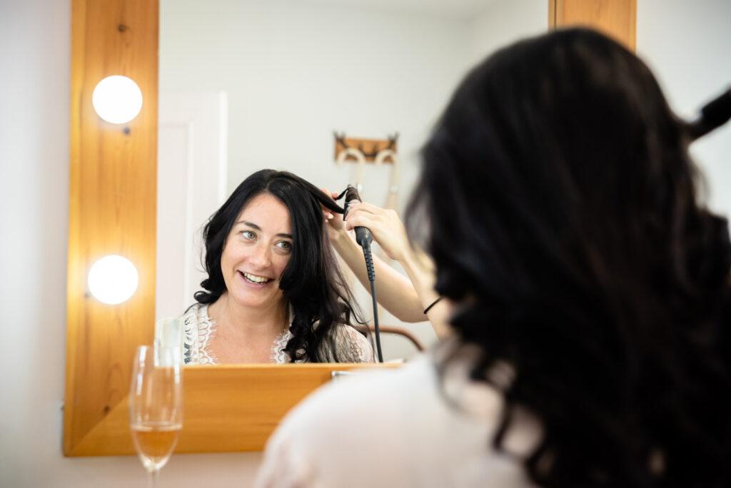 Bride having her hair done at Hanbury Wedding Barn