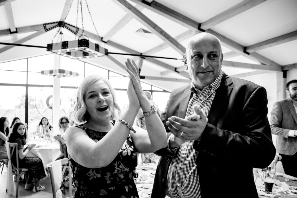 Guests cheering the bride and groom