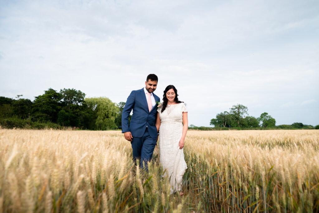 Wheat field wedding portrait at Hanbury Wedding Barn