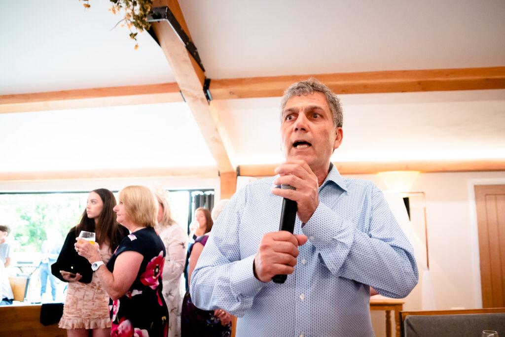Dad singing traditional jewish songs at Hanbury Wedding Barn
