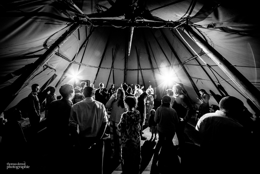 Wedding guests dancing in a tipi at Talton Lodge