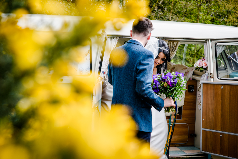 Bride getting out the VW camper van at Oak Tree of Peover
