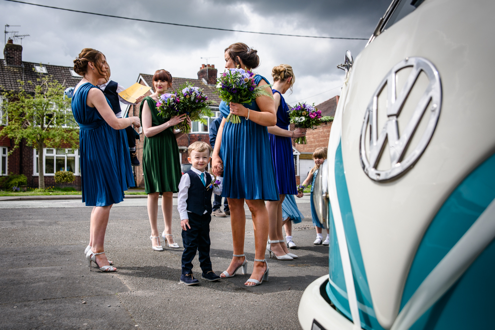 Bridal party waiting by the caper van
