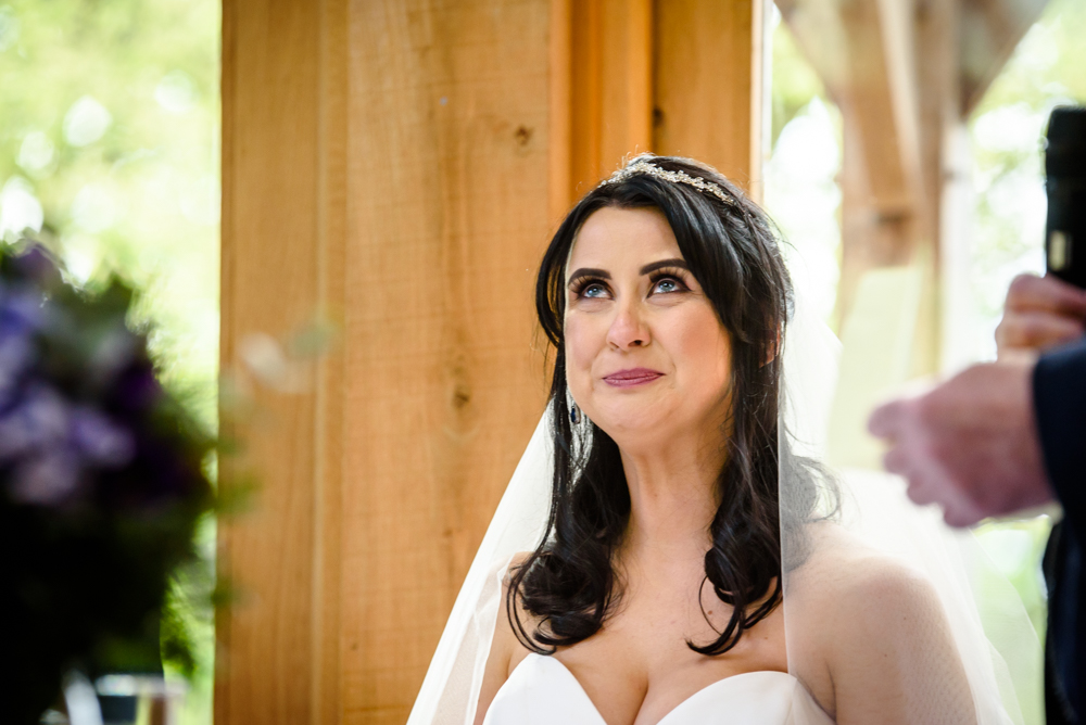 Bride getting emotional during the speeches at Oak Tree of Peover