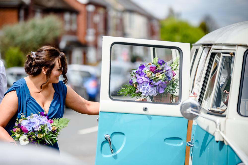 Bride getting out the camper van