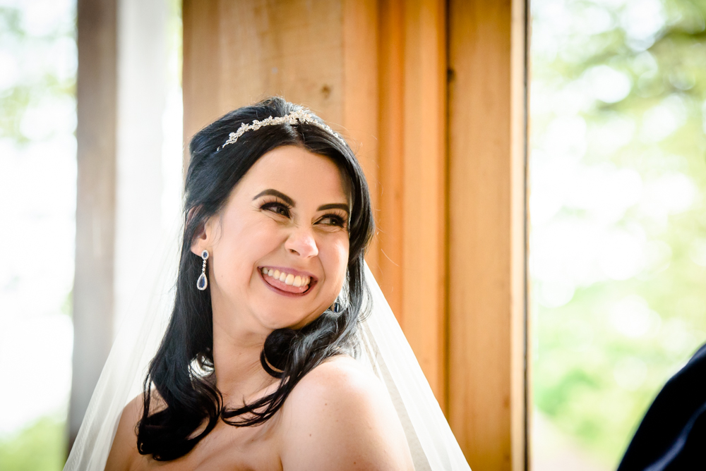 Bride laughing during the speeches at Oak Tree of Peover