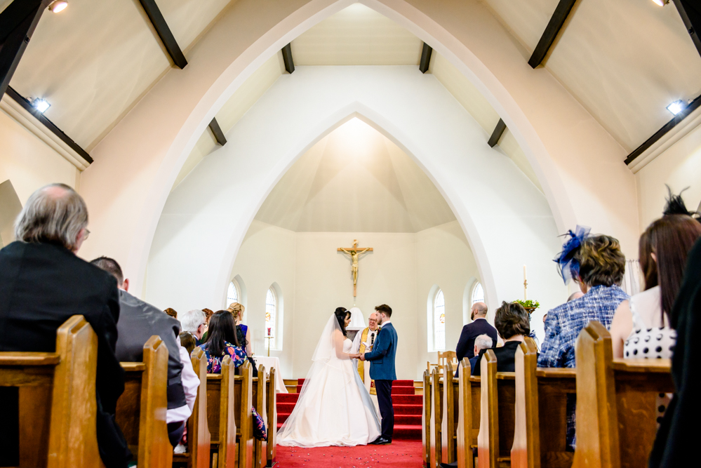 Bride and groom from down the aisle at St Mary's Church in Middlewich