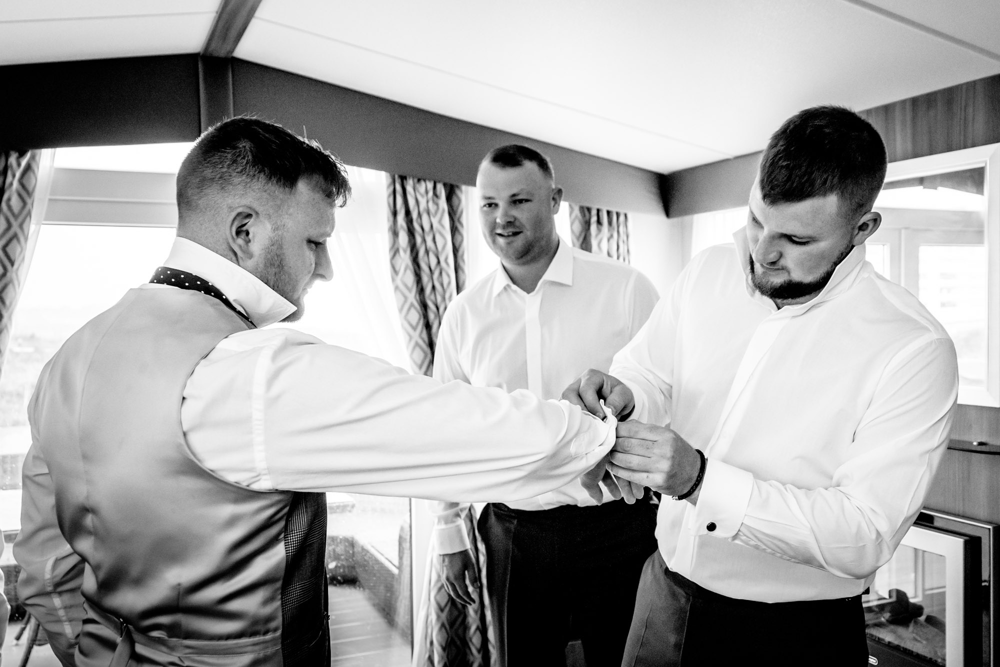 groomsmen getting dressed in rhosneigr