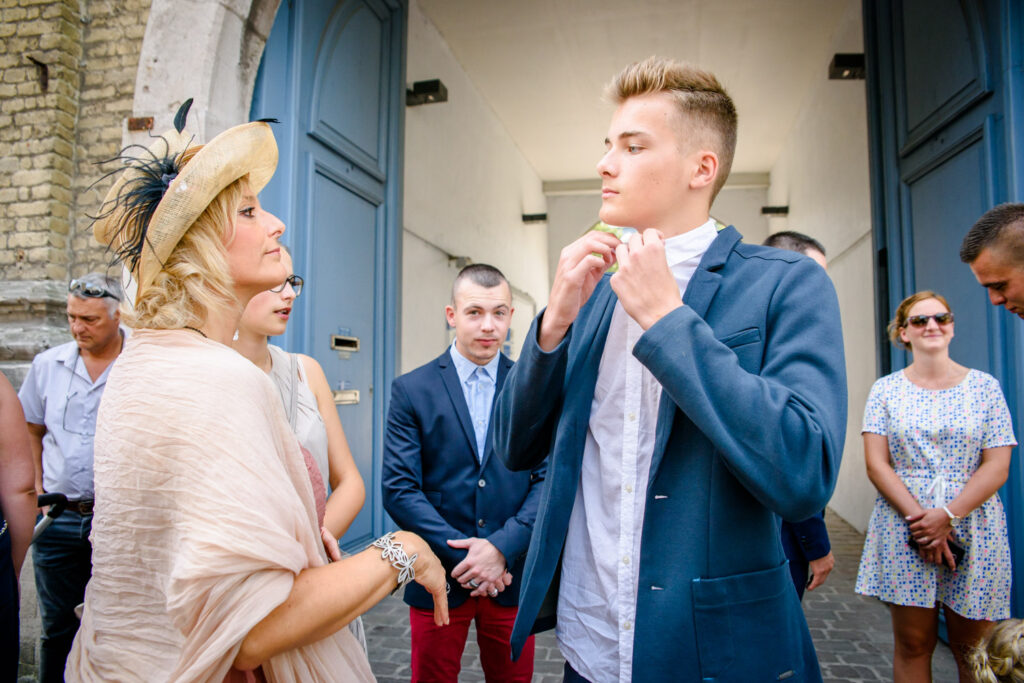 Wedding guest adjusting collar