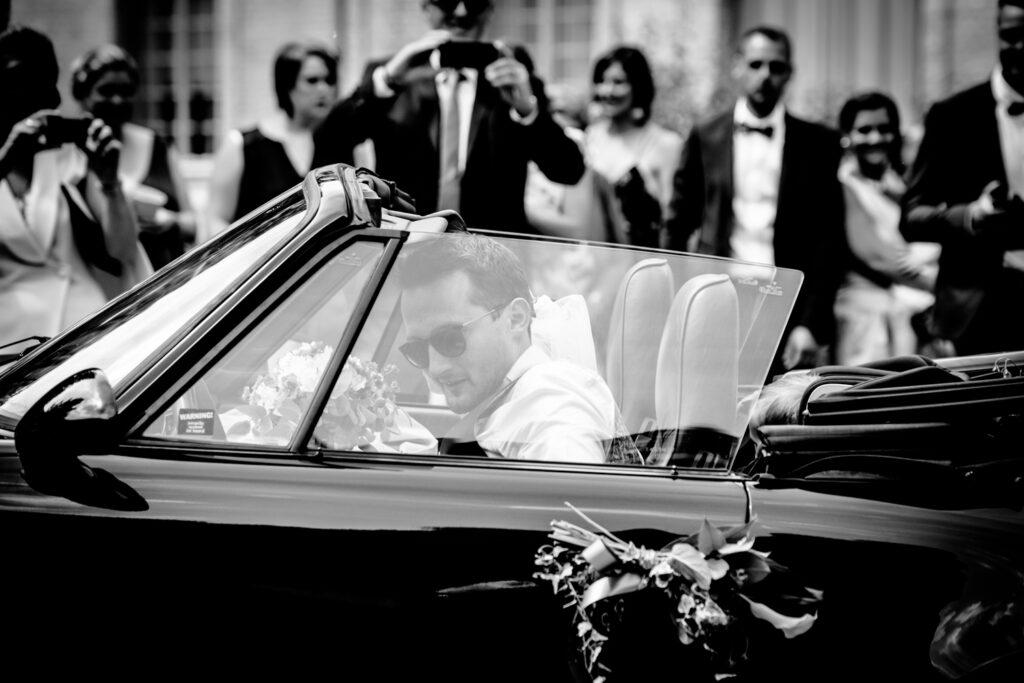 groom in fancy car