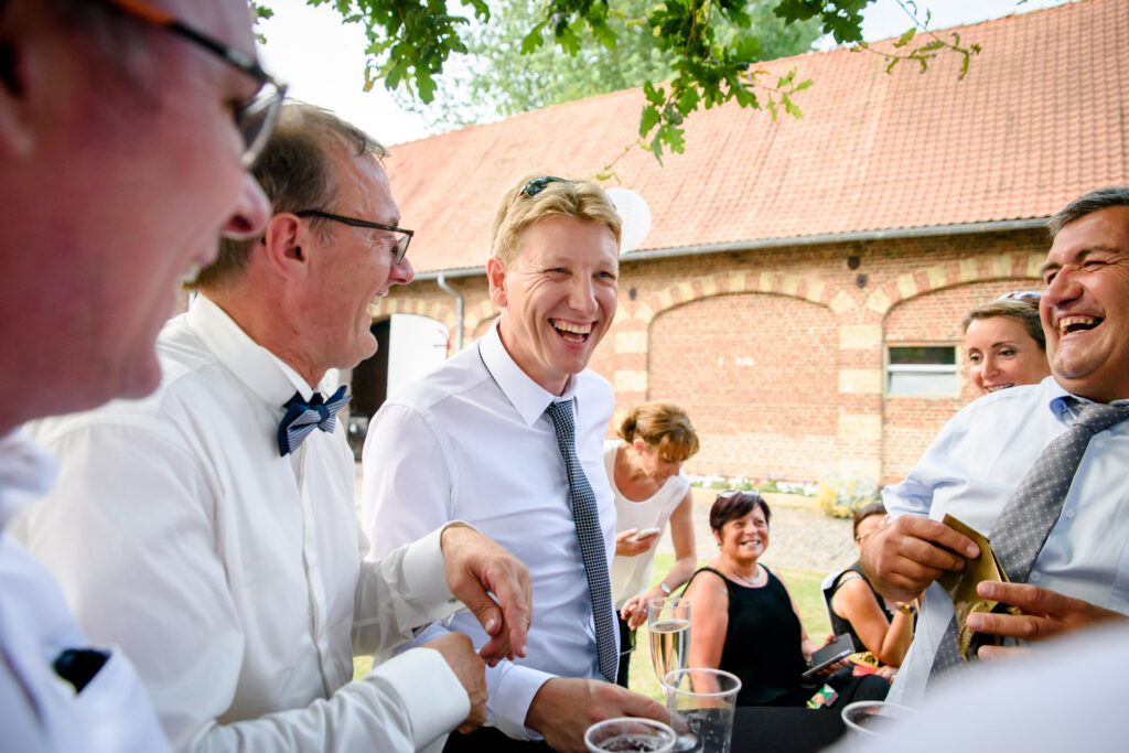 guests laughing during drink reception