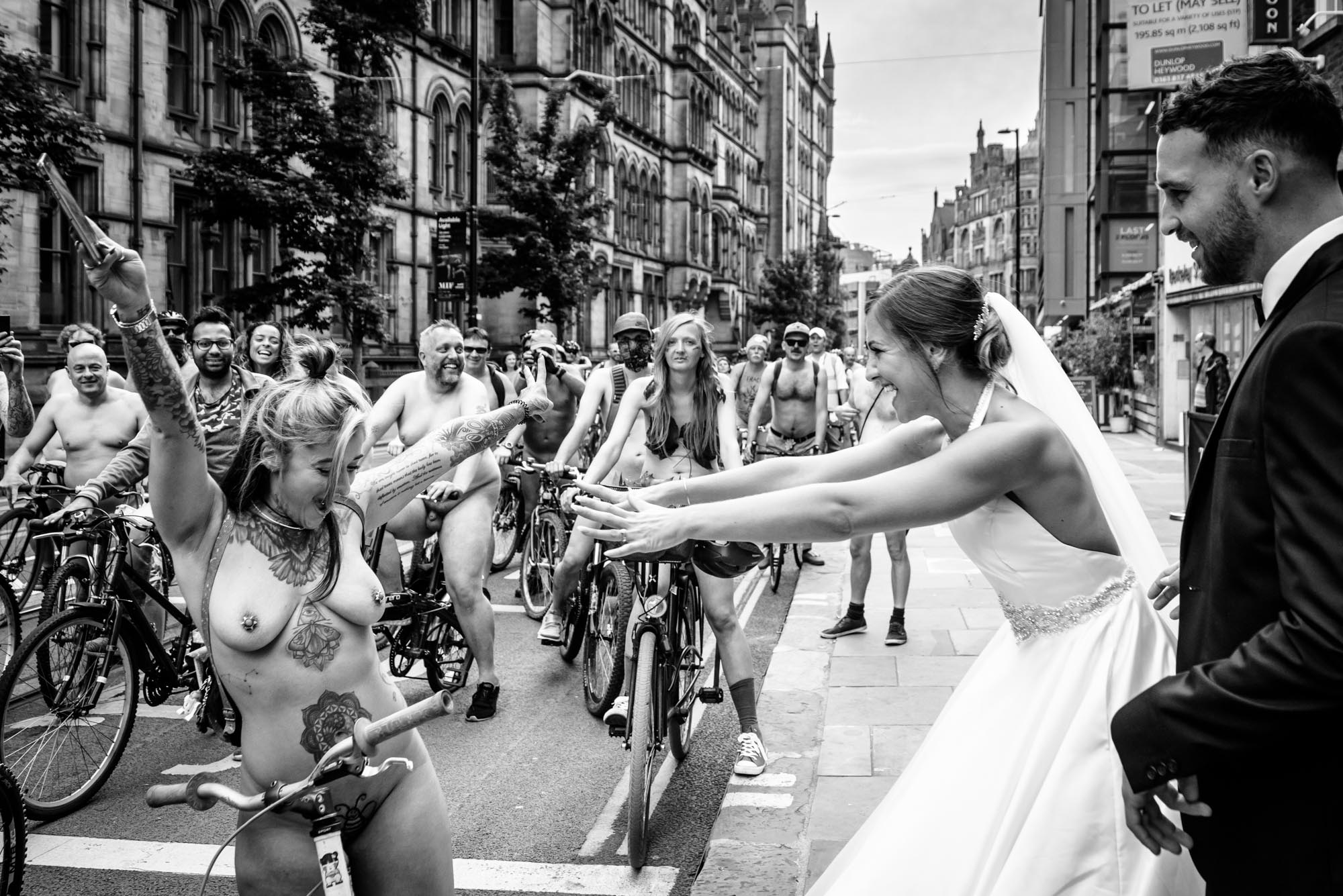 Bride sees her hairdresser at the Naked Bike Ride in Manchester