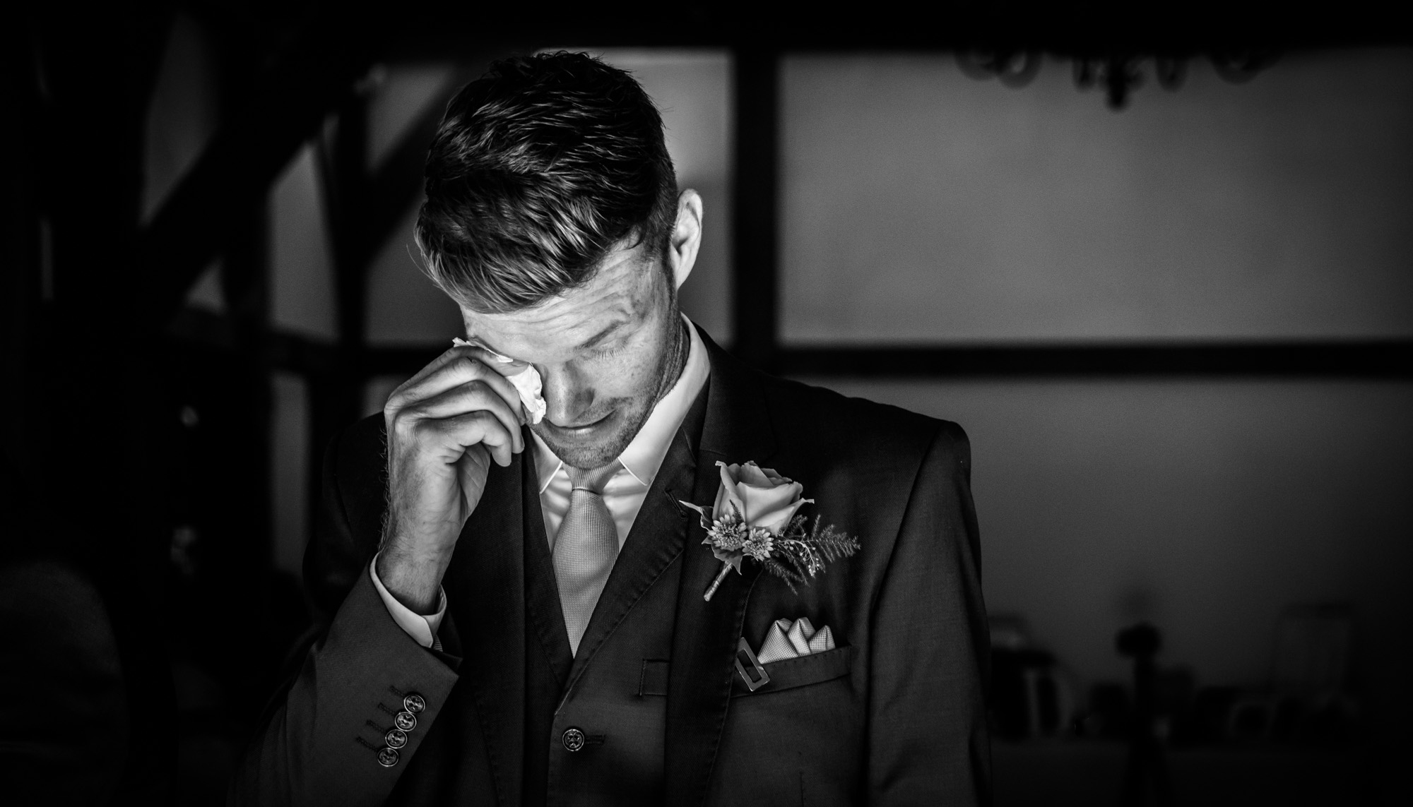 crying groom at sandhole oak barn in cheshire