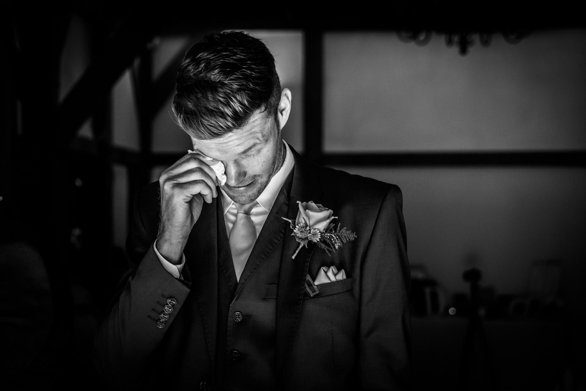 emotional groom waiting for the bride to arrive at Sandhole Oak Barn