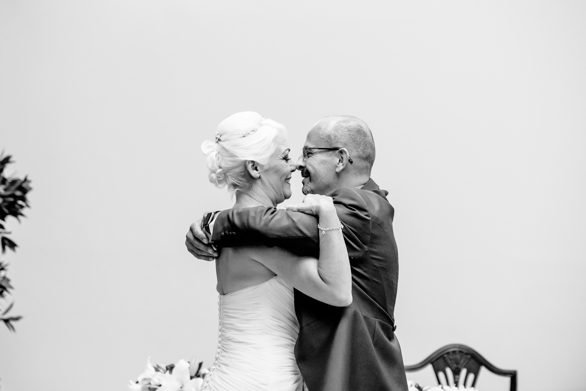 Bride and groom kissing - Stockport Town Hall