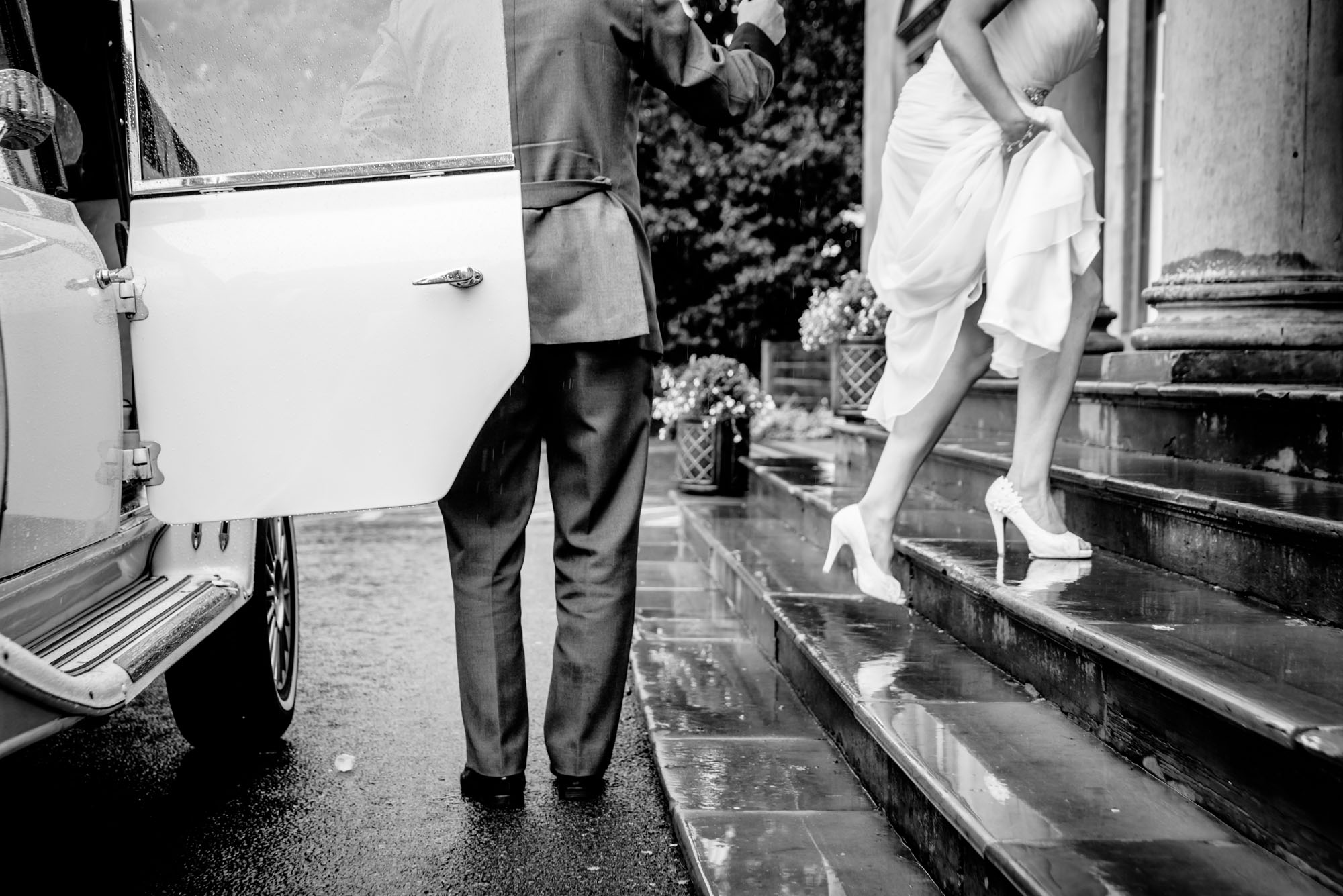 Bride arriving at Shrigley Hall in the rain
