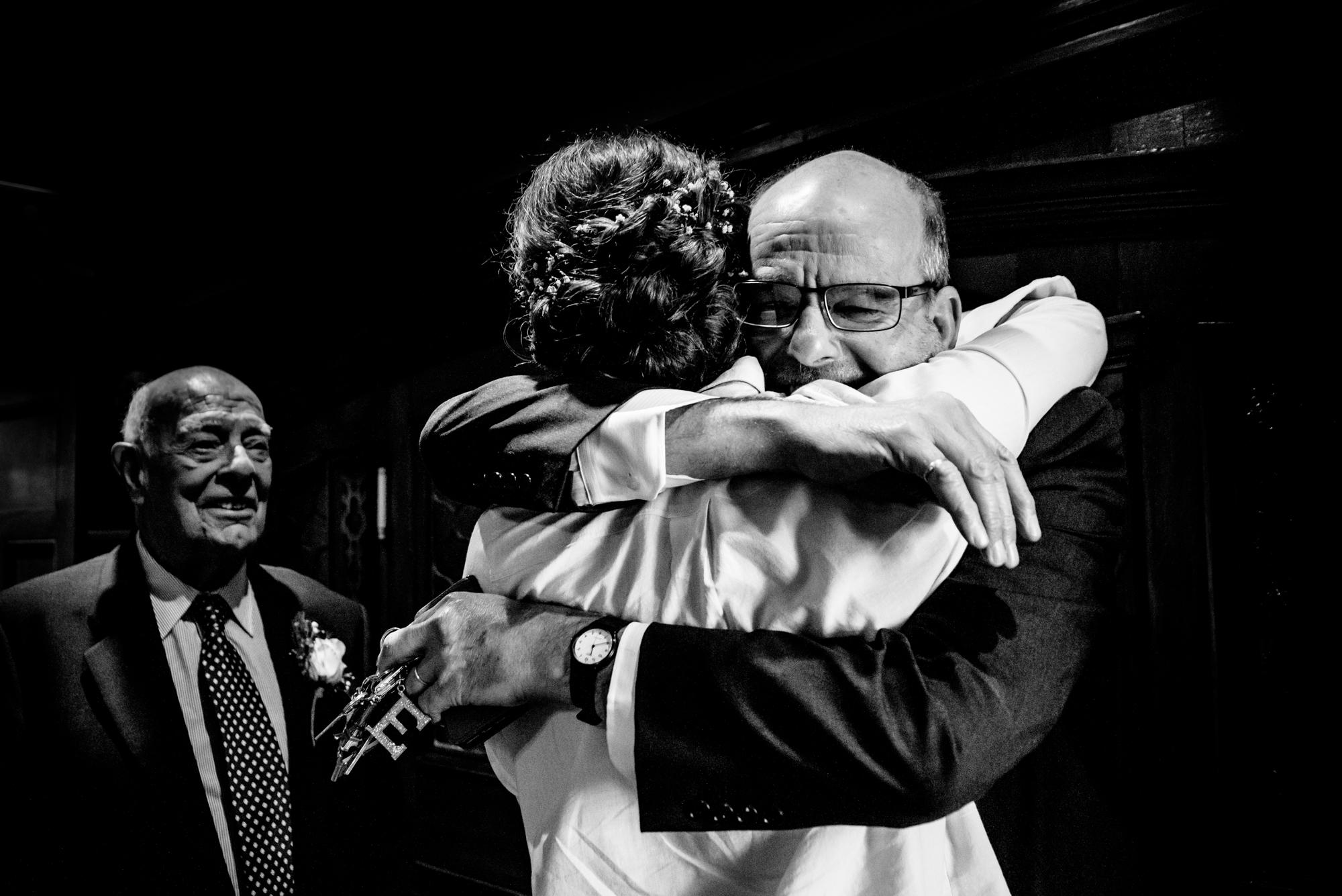 Father of he bride hug