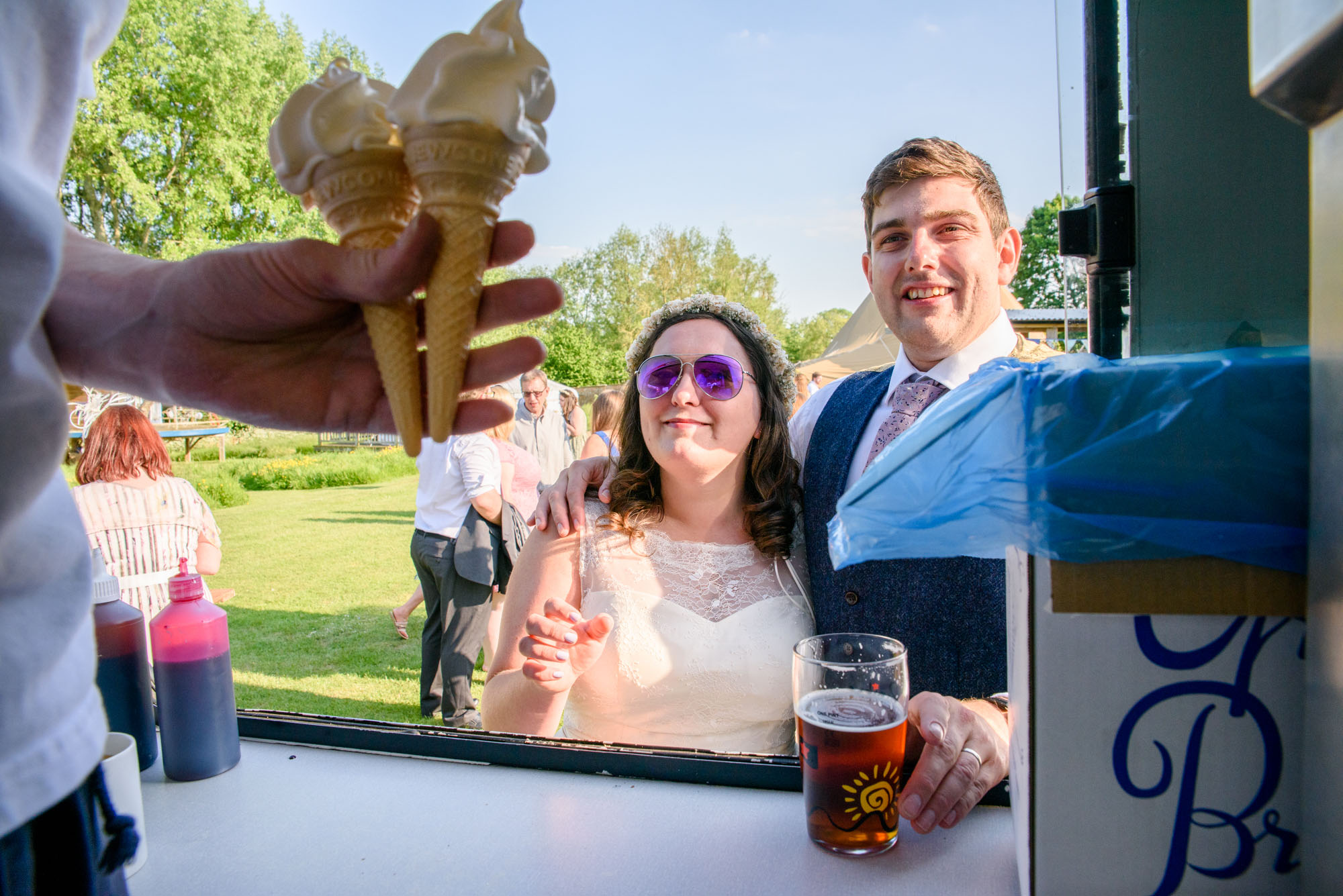 bride and groom having an ice cream from the van