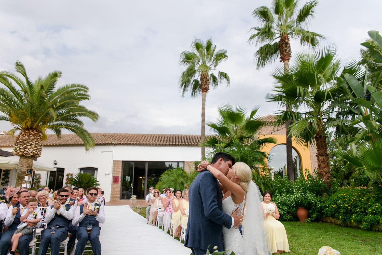 Wedding ceremony kiss at La Vinuela