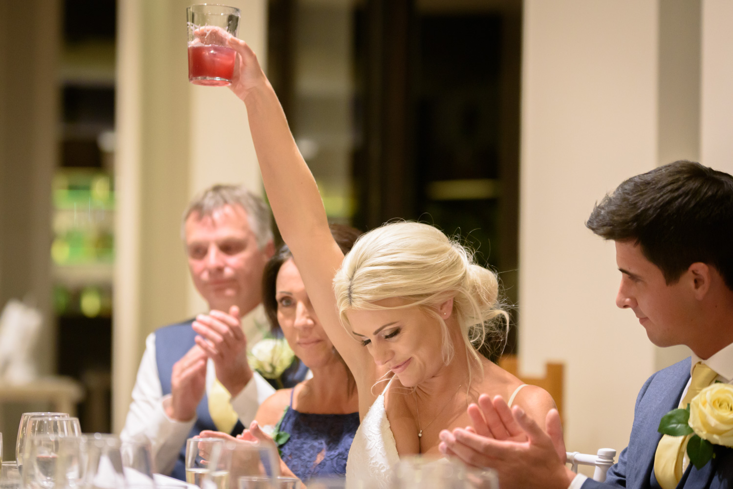 bride lifting her glass up