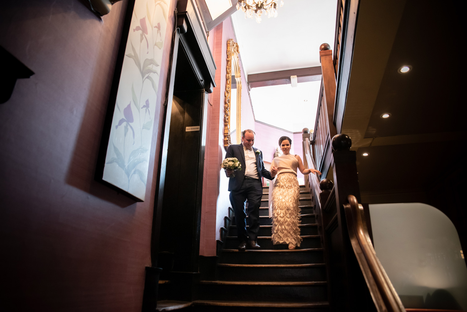 bride and grrom walking down stairs