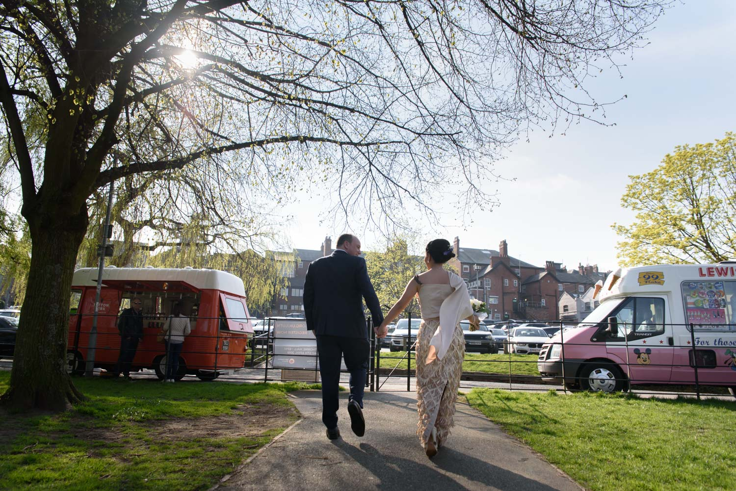 bride and groom with ice cream vans