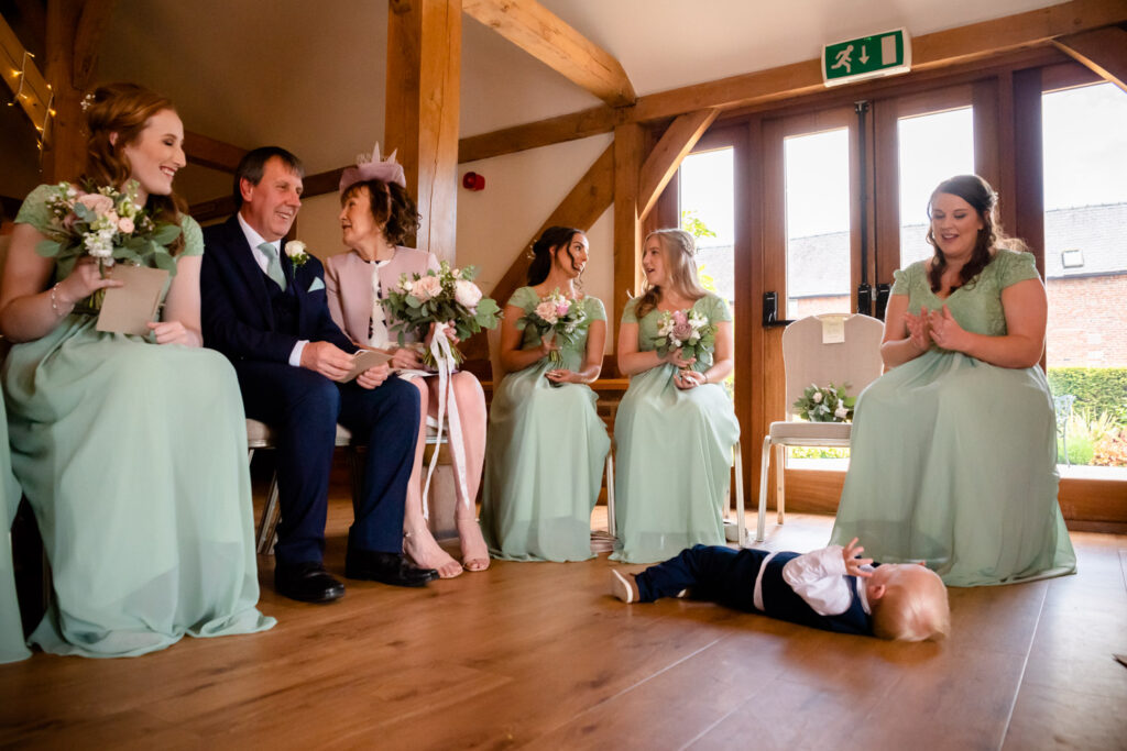 Child on the floor during the ceremony