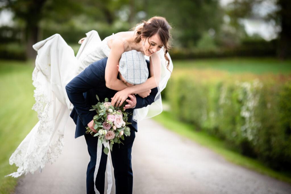 groom lifting the bride