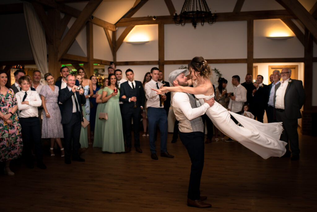 groom spinning the bride